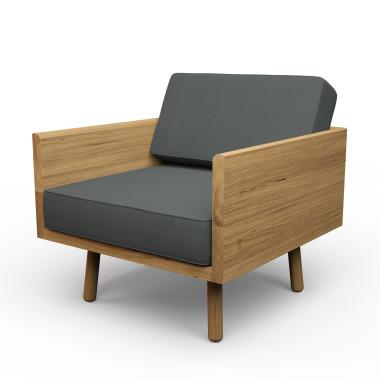 Duży dębowy fotel. Masywny mebel, który dzięki zastosowaniu owalnych, cienkich nóżek wygląda lekko i zgrabnie.Melyo.Grafitowy.