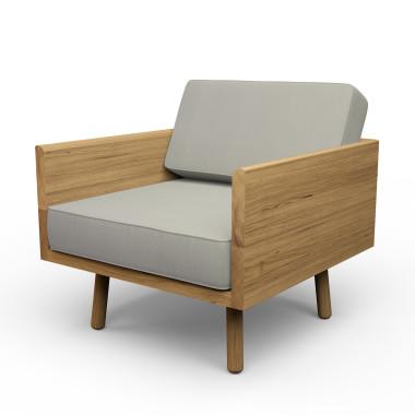 Duży dębowy fotel. Masywny mebel, który dzięki zastosowaniu owalnych, cienkich nóżek wygląda lekko i zgrabnie.Melyo.Szary.