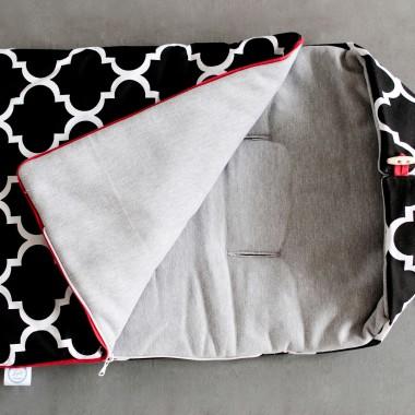 Zimowy śpiworek z ciepłym wypełnieniem. Za zewnątrz gruba bawełna, od środka gruba szara dresówka. Czzarny-koniczyna marokańska.