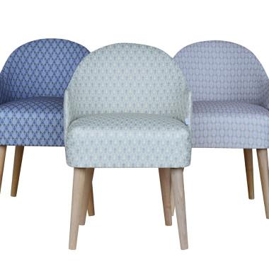 Oryginalny fotel z podłokietnikami inspirowany wzornictwem lat 60-tych . Bardzo wygodny, idealny do salonu, sypialni lub butiku.Pastelowy.