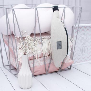 Beżowa pikowana nerka damska - modny dodatek do wiosennych stylizacji