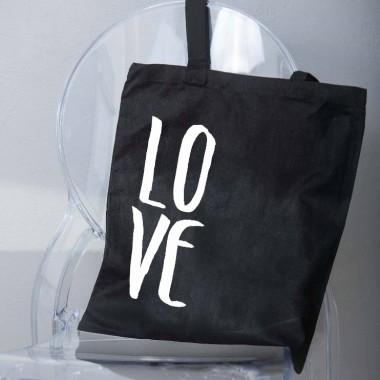 Czarno-biała torba materiałowa z napisem/nadrukiem.