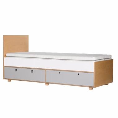 Szare łóżko z szufladami.
