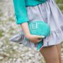 Modna, elegancka mała turkusowa torebka damska ze srebrnymi dodatkami: klamra i łańcuszek, na skórzanym pasku