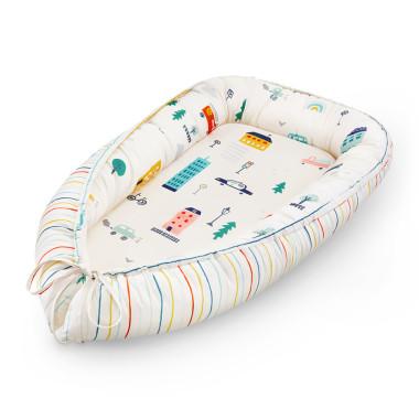 Dwustronny kokon dla niemowlęcia dopasowujący rozmiar
