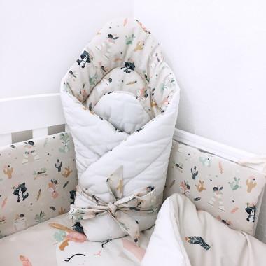 Dwustronny rożek niemowlęcy (becik) wykonany z wysokiej jakości bawełny w boho zwierzaki oraz miękkiego i miłego w dotyku velvetu w pikowane kwadraty.