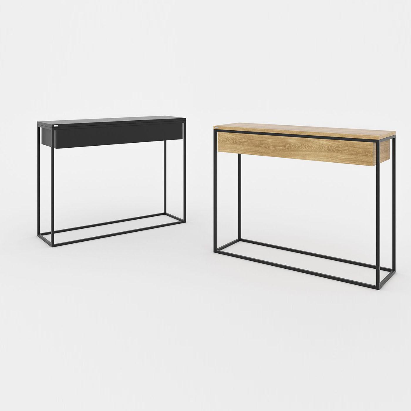 Minimalistyczna, nowoczesna konsola SKINNY XL z szeroką szufladą. Biała lub czarna.