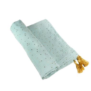 Otulacz wykonany z wysokiej jakości bawełnianego muślinu ozdobionymi kropeczkami w kolorze złota i chwostami.