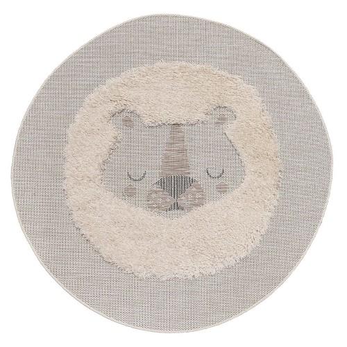 Okrągły, beżowy dywan z motywem śpiącego lwa to wspaniała propozycja do dziecięcego pokoju.